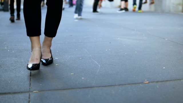 Close-up view of young female walking through the downtown. Businesswoman wearing black shoes with heels. Slow motion Close-up view of young female walking through the downtown. Businesswoman wearing black shoes with heels. Slow motion. Stylish woman walking in city center. shoe stock videos & royalty-free footage