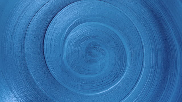 close-up view rotating spiral lines of trendy dark blue color, abstract background of infinity with copy space close-up view rotating spiral lines of trendy dark blue color, abstract background of infinity with copy space plate stock videos & royalty-free footage