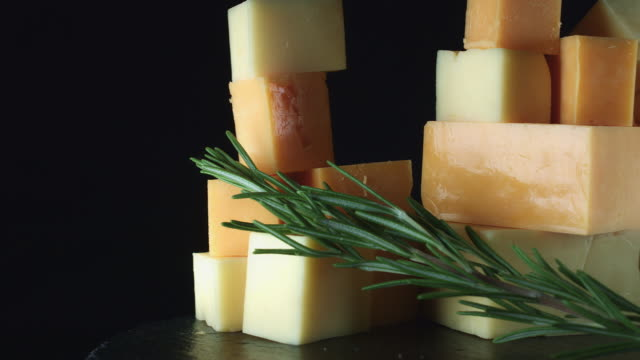 4K Close-up White and Red Cheddar Cheese with Herbs video