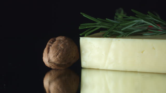 4K Close-up White Cheddar Cheese with Figs and Herbs video
