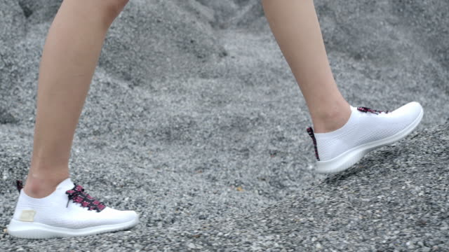 Close-up white shoes Walking on an adventure in the place of the Rock Grand Canyon