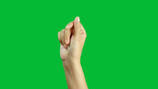 4K. close-up woman hand snap finger or clicks hand isolated on chroma key green screen