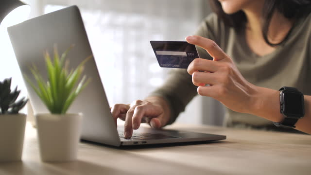 Close-up Woman Shopping online on her Laptop at home Close-up Woman Shopping online on her Laptop at home credit card purchase stock videos & royalty-free footage