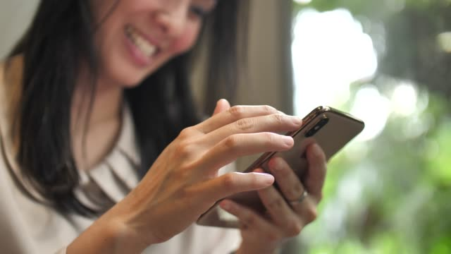Close-up Woman uses smart phone