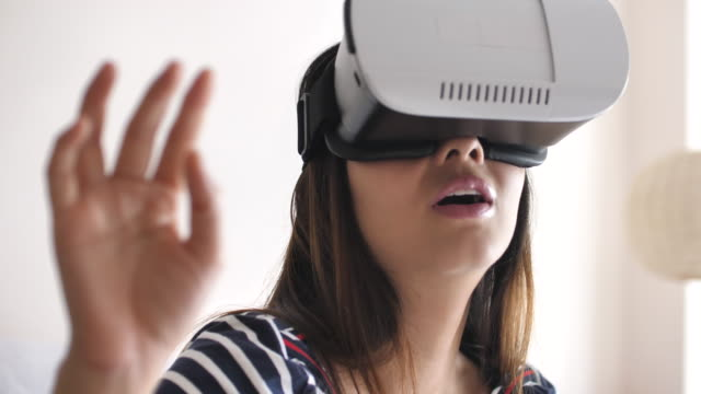 Close-up Woman using a virtual reality glasses at home, Slow motion video