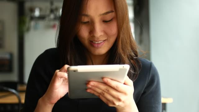 Close-up Woman using Digital tablet