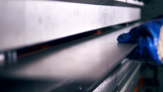 Close-up. Worker bending metal on a modern bending industrial machine at a factory. video