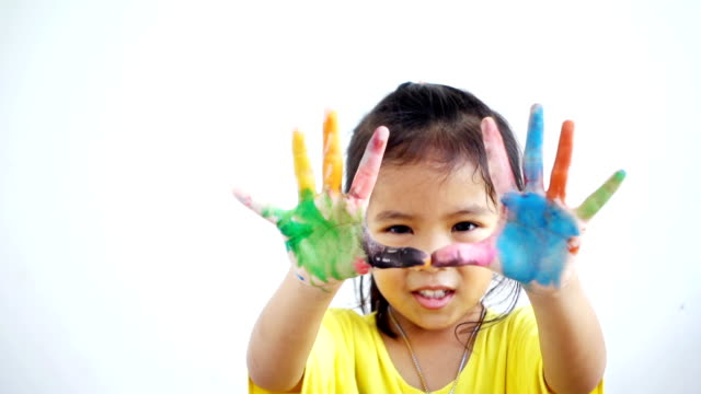 Close-up young girl shows her hands to the camera. Portrait funny girl coloring. Slowmotion of full hd video footage. video