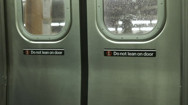 Closing The Doors Of The Train. Subway Of New York. Close-up. Train Is Closing The Door. Do Not Lean On Door. Subway Station In New York. Close-up. new york city subway stock videos & royalty-free footage
