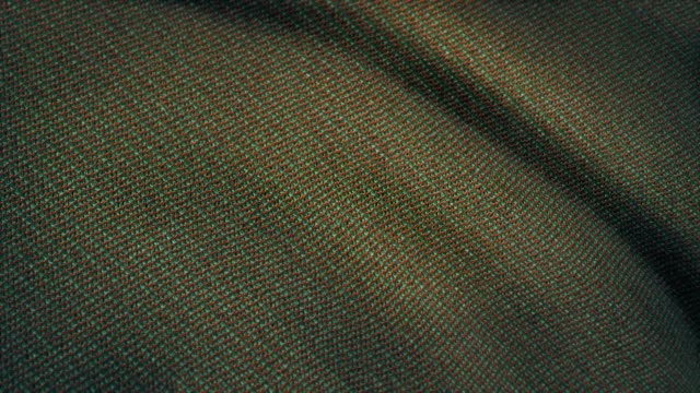 Cloth flutters. Waves of canvas animation. Background of satin fabric. Fabric background animation fluttering in the wind