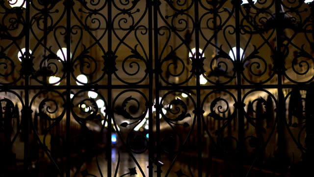 Cloth Hall behind a locked iron gate night background Sights and monuments of architecture wrought iron stock videos & royalty-free footage