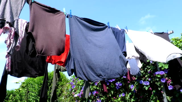 clothes hanging out moving by the wind