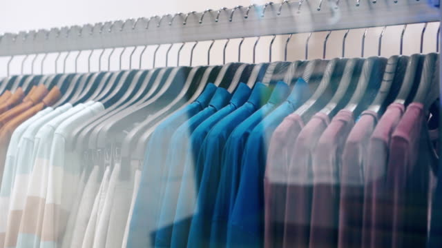 Clothes hanging rail in clothes shop 4k footage clip of Clothes hanging rail in clothes shop collection stock videos & royalty-free footage