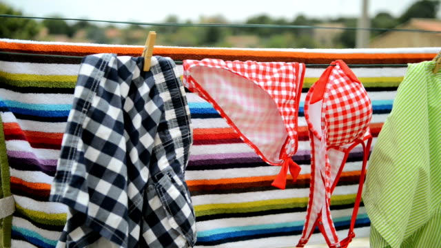 clothes line with bikini clothes line  swimwear stock videos & royalty-free footage