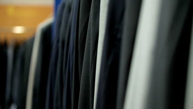 Clothes on coat rack in boutique video