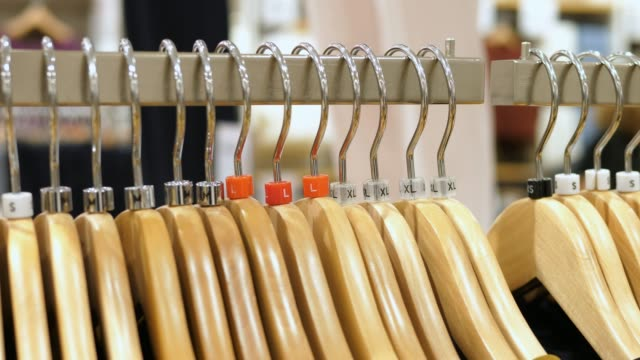 Clothes on Hangers In Clothing Shop. Shopping Concept