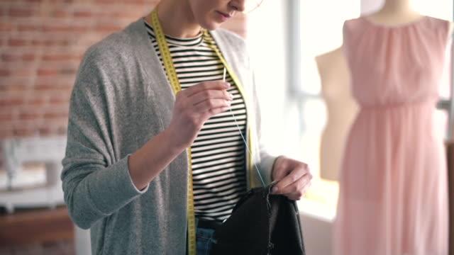 clothing designer sewing fabric - sarta video stock e b–roll