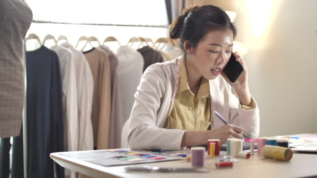 Clothing designer Working talking with her Customer