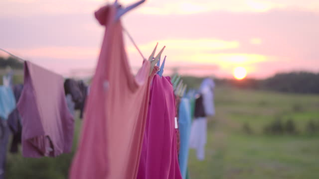 Clothing drying in the wind on sunset