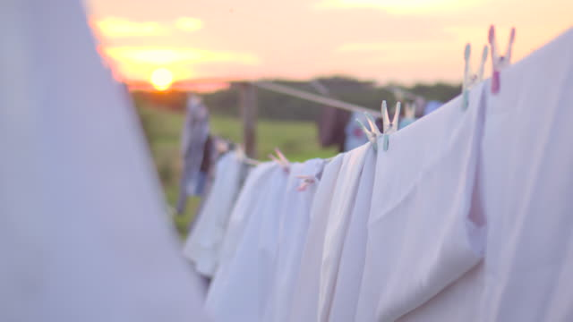 Clothing drying in the wind on sunset Clothing drying in the wind on sunset hanging stock videos & royalty-free footage