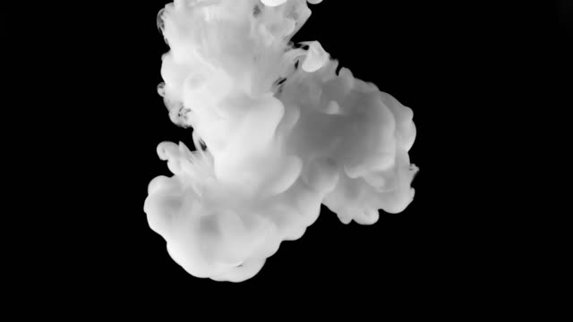 SLO MO LD Cloud of white colour expanding underwater against black background