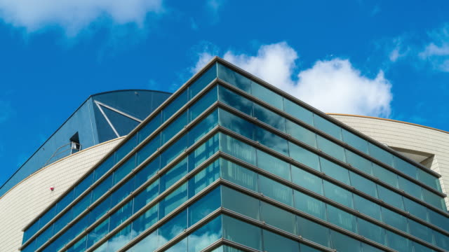 Cloud reflected in glass building