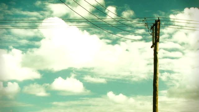 Cloud timelapse over a telephone pole video