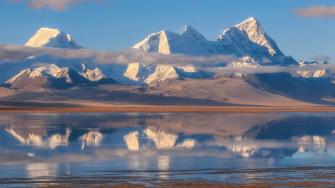 Clouds and fog surround zhuomurari mountain, reflecting in the lake, just like a picture This is zhuomurari mountain in Tibet extreme terrain stock videos & royalty-free footage