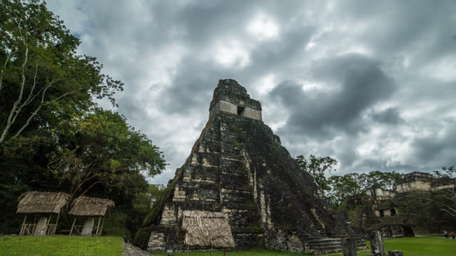 Clouds Behind Mayan Temple Time Lapse Clouds moving behind Mayan Temple at Tikal in Guatemala. old ruin stock videos & royalty-free footage