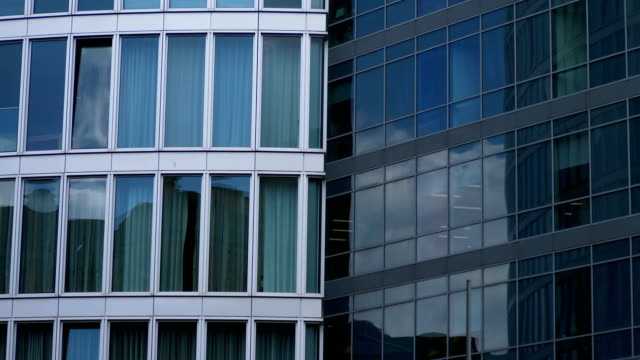 clouds flowing slowly  reflecting on Glass Business Building video