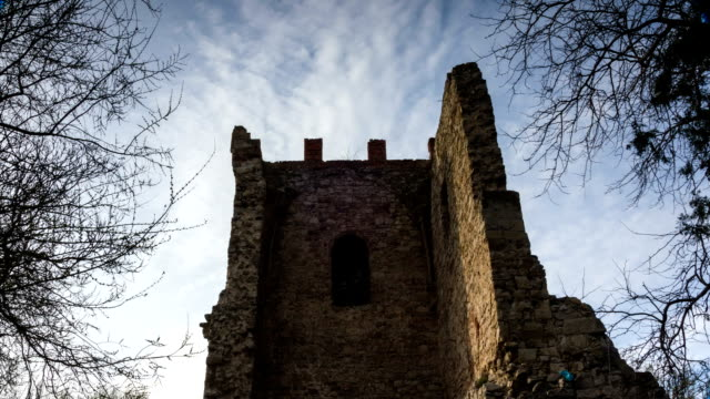 clouds fly over the ruins of an ancient tower - medieval architecture stock videos & royalty-free footage