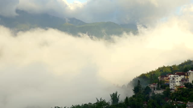 Clouds Mountains Sapa Vietnam Above the clouds. The town of Sapa and terraced rice paddies in Northern Vietnam covered in low clouds. sa pa stock videos & royalty-free footage