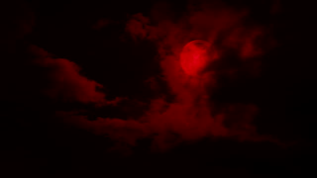 Clouds Move Back Revealing Red Moon Night sky with big clouds moving across a red moon count dracula stock videos & royalty-free footage