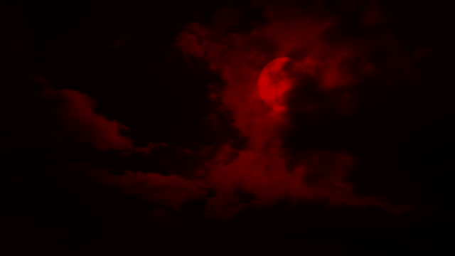 Clouds Move Over A Red Moon Night sky with big clouds moving across a full moon count dracula stock videos & royalty-free footage