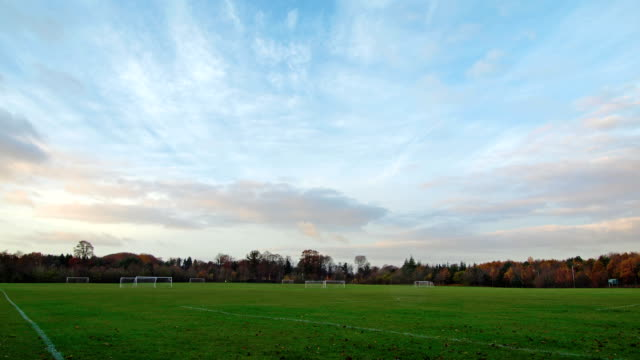 clouds moving over football field in timelapse video