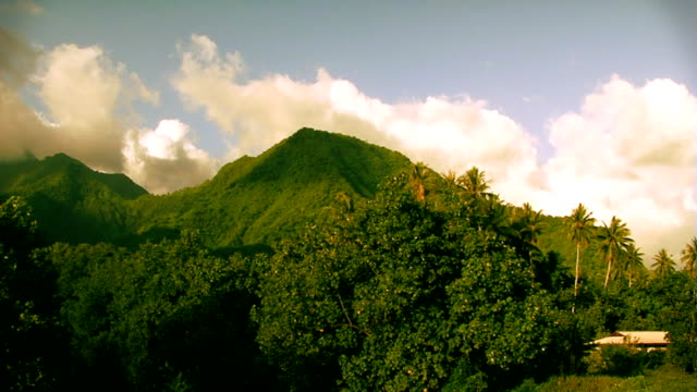 Clouds moving over tropical hill in Tahiti video