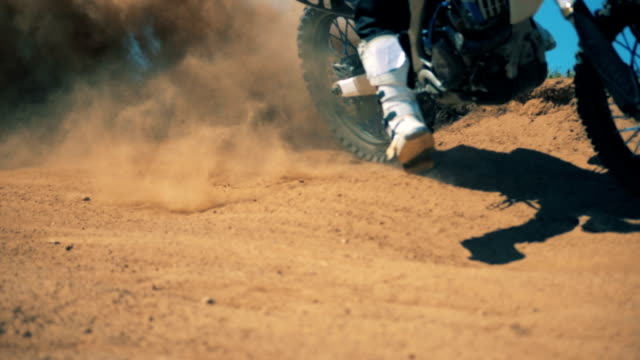 clouds of dirt raised after high-speed passing of a sportbike - supercross video stock e b–roll