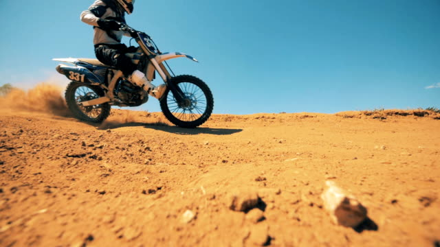 clouds of dust are getting raised after autobike's driving through the terrain - supercross video stock e b–roll