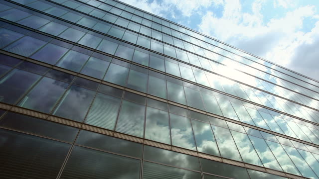 Clouds over office windows