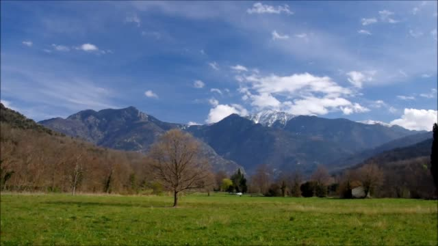 clouds over snow covered Pic du Canigou, Pyrenees timelapse video