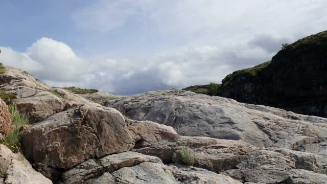 clouds over the rocks, mountain landscape. averoy, norway. low-angle shot, - nord europeo video stock e b–roll