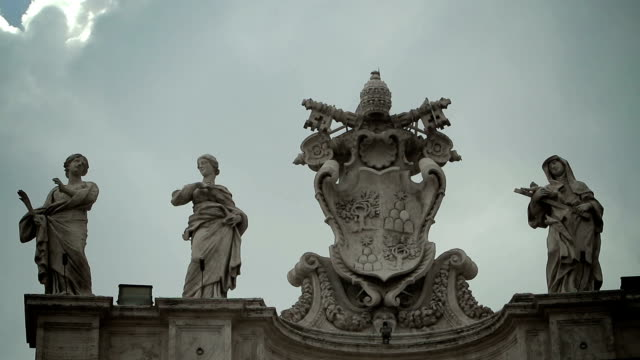 clouds over the statues of Bernini's colonnade in St Peter's Square video