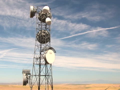 Clouds pass over a cell tower video