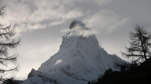stockvideo's en b-roll-footage met clouds pass summit of matterhorn, after fresh snowfall - matterhorn