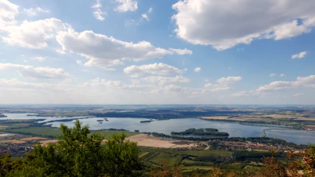 Clouds passing blue lakes landscape time lapse in Moravia