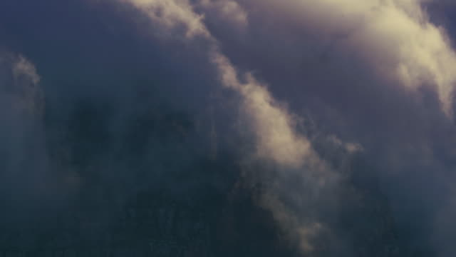 Clouds Pouring over Table Top Mountains Clouds pouring over the Table Top Mountain in South Africa like a waterfall. Shot in 4K resolution. cape peninsula stock videos & royalty-free footage