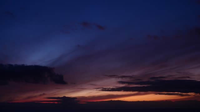 Cloudscape at sunrise. Dark sky and moring light. Cloudscape at sunrise. Dark blue sky and moring first light on horizon. Daybreak dark blue stock videos & royalty-free footage