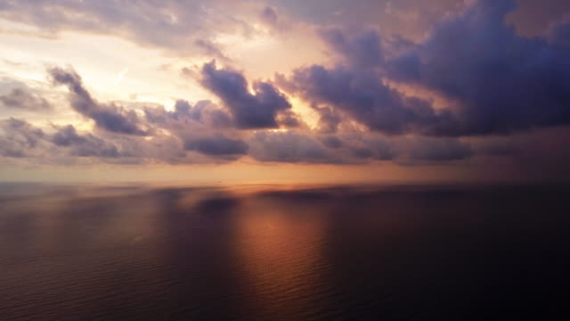 Cloudscape Bronze Sunset on the Sea. Clouds on the sky. Natural color. Sea Horizon AERIAL 4K footage. video