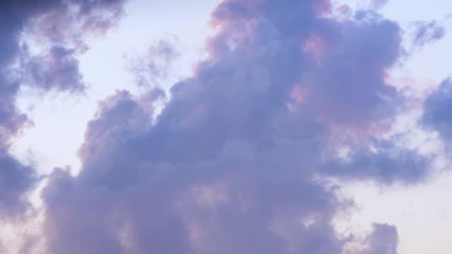 Cloudscape, dramatic cumulus clouds movement in sunset