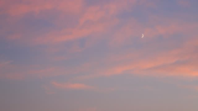 cloudscape. evening sky with moon and clouds hd - полумесяц форма предмета стоковые видео и кадры b-roll